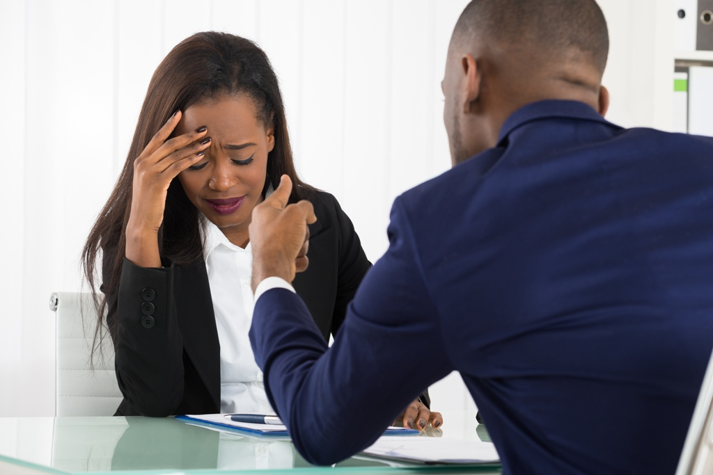 Man talking to a woman and she looks stressed